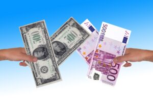 exchange rates are illustrated in this photo showing dollars to euros in two different hands